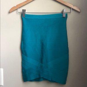 Bebe blue mini bandage skirt